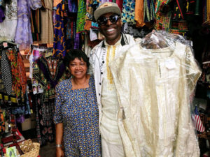 Paradise-Queen-Mother-Theresa-owner-African-Rainbow-Boutique-by-Amaranth-web-300x225, 'Black Panther' sets off Back to Afraka fashion craze, Culture Currents