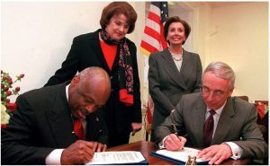SF-Mayor-Willie-Brown-US-Navy-Secy-Gordon-England-sign-legislation-re-Hunters-Point-Treasure-Island-Naval-Base-as-Sen.-Feinstein-Rep.-Pelosi-watch-2002-2-300x185, Death and courage at the Hunters Point Shipyard, Local News & Views