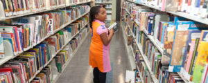 Bayview-Linda-Brooks-Burton-Library-lil-Black-girl-choosing-books-web-300x120, SF Library plans to install privacy-threatening RFID tags into books and materials despite EFF, ACLU-NC, Library Users Assoc. opposition, Culture Currents