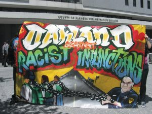 Gang-injunction-protest-banner-Oakland-against-racist-injunctions-2011-300x225, More police, criminalization and gang suppression will not end homelessness in San Francisco, Local News & Views