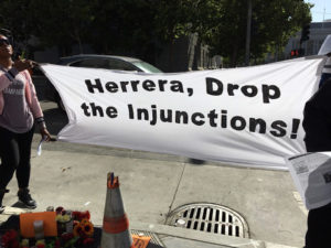 Herrera-Drop-the-Gang-Injunctions-vigil-prior-to-ct-hrg-to-remove-enjoined-men-who-died-062818-by-Daniel-Montes-Bay-City-News-web-300x225, More police, criminalization and gang suppression will not end homelessness in San Francisco, Local News & Views