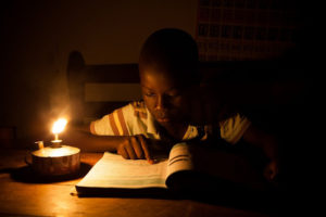 African-boy-reading-by-lamplight-by-Corrie-Wingate-SolarAid-300x200, Nuclear power in Africa?, World News & Views