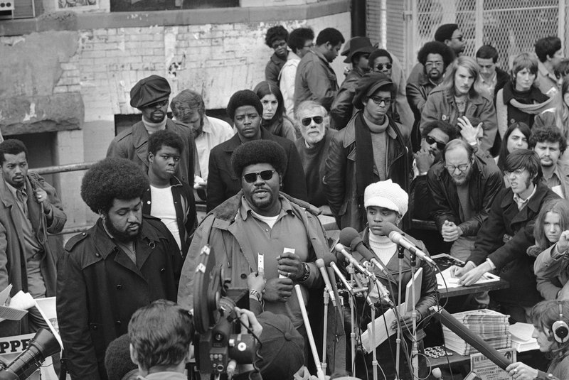 Black-Panther-Party-Deputy-Minister-of-Information-Elbert-Big-Man-Howard-holds-sidewalk-news-conf-in-DC-112770-by-Charles-W.-Harrity-AP, Rest in power, Elbert 'Big Man' Howard, founding father of the Black Panther Party, World News & Views
