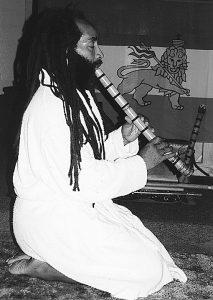Veronza-Bowers-Jr.-playing-shakuhachi-flute-kneeling-bw-web-213x300, Veronza, don't die in prison!, Behind Enemy Lines