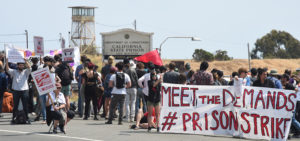 National-Prison-Strike-San-Quentin-West-Gate-crowd-Meet-the-Demands-PrisonStrike-banner-guard-tower-082518-by-G.-Sharat-Lin-web-300x141, Reports back from the first week of the 2018 National Prison Strike, Behind Enemy Lines