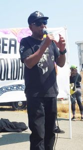National-Prison-Strike-San-Quentin-lead-organizer-Bilal-Mafundi-Ali-at-mic-082518-by-Laura-Guzman-167x300, Large turnout for San Quentin action in support of National Prison Strike, Behind Enemy Lines