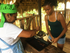 Amani-Sawari-grinds-crushed-cacao-nuts-into-a-thick-paste-with-farm-owner-and-striker-in-BriBri-Limon-Costa-Rica-0918-web-300x225, Parallels between national strikes, from prisoners in the US to teachers in Costa Rica, World News & Views