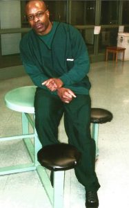 Bomani-Shakur-Keith-LaMar-sitting-on-table-187x300, 'An execution date should not be scheduled' for Bomani Shakur (Keith LaMar), Behind Enemy Lines