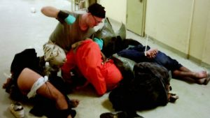 Charles-Graner-from-SCI-Greene-beats-prisoners-at-Abu-Ghraib-300x169, The anatomy of abusive prison guards: Telford Unit's overt assault and punishment program, Behind Enemy Lines
