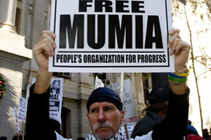 Free-Mumia-Peoples-Organization-for-Progress-elderly-man-protests-300x199, The right to rape, National News & Views