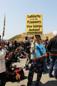 National-Prison-Strike-San-Quentin-West-Gate-Erika-Hidalgo-holds-George-Jackson-sign-082518-by-Sara-Hossaini-KQED-web-200x300, Few prisoners strike at San Quentin, Behind Enemy Lines
