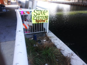 Stop-Evictions-Now-sign-at-homeless-encampment-Lake-Merritt-by-Kheven-LaGrone-1018-web-300x225, Does Martin v. Boise mean no more evictions of homeless people?, Local News & Views