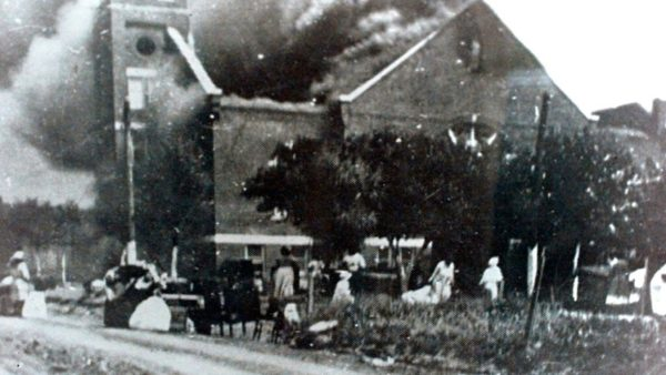 Mt. Zion Baptist Church burns after being torched by white mobs during the 1921 Tulsa massacre.