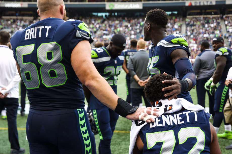 buy popular 6788a da465 Seattle Seahawks Jason Britt, Frank Clark support seated ...