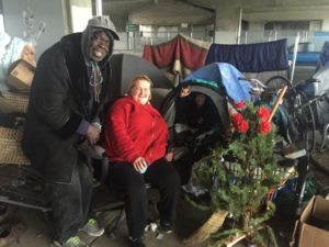 Michael-Chevalier-Christine-Rose-Lisa-Blowers-in-tent-wished-passersby-'Happy-holidays'-encampment-under-Interstate-80-overpass-Gilman-St-Berkeley-121516-by-Tom-Lochner-300x225, Caltrans and Martin v. Boise, Local News & Views