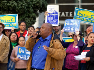 Props-10-C-rally-on-Golden-Gate-Ave-Rev.-Harry-Williams-speaks-by-Kevin-N.-Hume-SF-Examiner-300x225, Tenant advocates celebrate Prop C's historic victory and vow to keep fighting for affordable housing and fair rents, Local News & Views