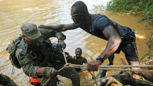 Africom-Ghanaian-soldier-trains-US-soldier-in-Ghana-by-Africom.mil-web-300x169, Black internationalists demand closure of hundreds of U.S. military bases, World News & Views