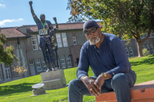 Dr.-Harry-Edwards-sits-before-Olympic-Black-Power-Statue-of-Tommie-Smith-John-Carlos-by-Rigo-on-SJSU-campus-2018-by-Santiago-Mejia-SF-Chron-web-300x200, About Jamil Al-Amin (H. Rap Brown) and the 1968 Olympic protest: An interview with Dr. Harry Edwards, World News & Views