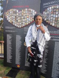 Jonestown-Memorial-40th-anniv.-Iya-Wanda-Ravernell-founder-Ominira-Prod.-hosted-African-Grave-Sweeping-Ceremony-3-yrs-111818-by-Wanda-Sabir-web-225x300, Wanda's Picks for December 2018, Culture Currents