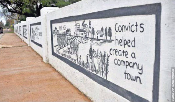 Convicts-helped-create-a-company-town'-painting-on-a-bridge-in-Sugar-Land-Imperial-Sugar's-company-town-by-Monica-Rhor-USA-Today, The Sugar Land 95: Help us protect the sacred burial ground of our ancestors in Texas, National News & Views