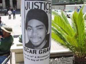 Justice-for-Oscar-Grant-Gather-at-14th-Broadway-on-the-day-of-the-verdict-flier-on-light-pole-070110-by-Dave-Id-Indybay-300x225, A celebration of the Justice for Oscar Grant protesters, Local News & Views