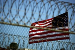 Prison-nation-US-flag-seen-thru-prisons-peripheral-razor-wire-300x200, First Step Act: US Senate passes bipartisan criminal justice bill, Behind Enemy Lines