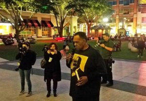 Reginald-Moore-head-of-the-Convict-Labor-and-Leasing-Project-speaks-for-Sugar-Land-95-at-candlelight-vigil-in-Sugar-Land-Town-Square-121618-300x207, The Sugar Land 95: Help us protect the sacred burial ground of our ancestors in Texas, National News & Views