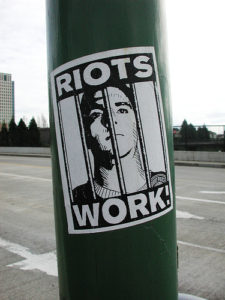 Riots-work-flier-of-Oscar-Grant-killer-cop-Mehserle-behind-bars-on-light-pole-at-12th-St-I-980-overpass-Oakland-early-2009-by-Dave-Id-Indybay-225x300, A celebration of the Justice for Oscar Grant protesters, Local News & Views