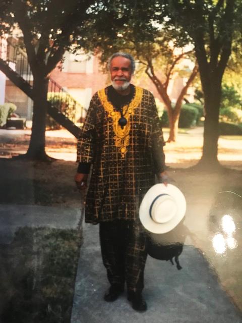 Eugene-E.-White-on-sidewalk, Beloved artist Eugene E. White passes, Culture Currents