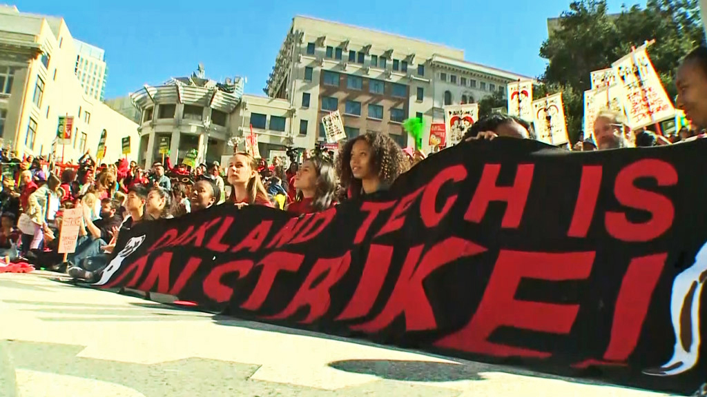 Oakland-Teacher-Strike-Oakland-Tech-On-Strike-banner-held-by-students-022119-by-CBS-SF, Reflections of an Oakland Unified School District teacher on strike – Day 1, Local News & Views