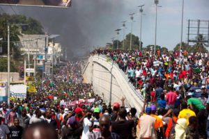 Protesting-PetroCaribe-theft-demanding-resignation-of-President-Moise-Haitians-fill-streets-Port-au-Prince-020719-by-Dieu-Nalio-Chery-AP-300x200, As U.S. intervention germinates in Venezuela, we must not forget the implications for Haiti, World News & Views