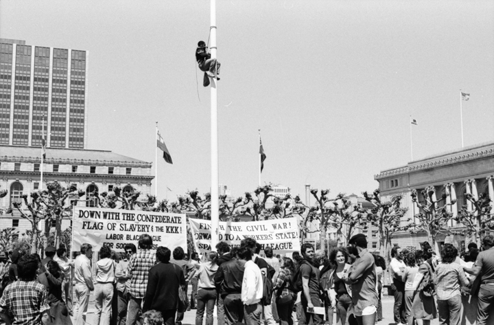 Spartacist-League-supporter-Richard-Bradley-climbs-flagpole-SF-Civic-Center-to-remove-Confederate-battle-flag-041584-by-Workers-Vanguard-web, It's true: As San Francisco mayor, Dianne Feinstein did repeatedly fly a Confederate flag in front of City Hall, Local News & Views