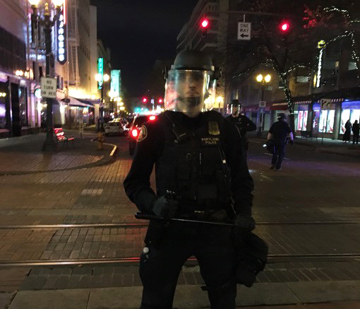 White-cop-stands-in-city-intersection-at-night-by-Nathaniel-St.-Clair, Black women political prisoners of the police state, Behind Enemy Lines