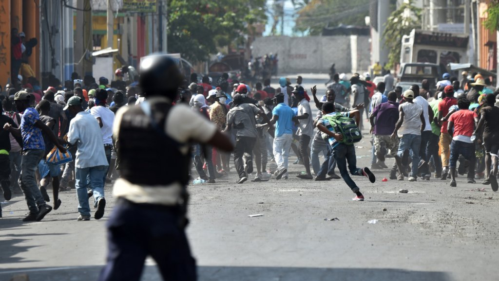 Haitian-police-open-fire-on-protesters-on-7th-day-of-protests-against-Pres-Moise-in-Port-au-Prince-021319-by-Hector-Retamal-AFP, Congress members call Haitians 'violent' for marching unarmed against government forces shooting live ammunition, World News & Views