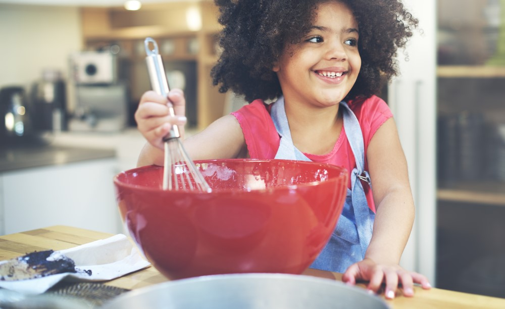 Lil-Black-girl-helping-fix-dinner, Reviving the family dinner, Culture Currents