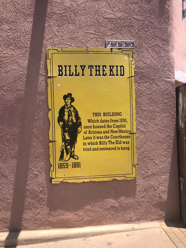 Billy-the-Kid-plaque-on-bldg-where-he-was-tried-sentenced-to-death-by-Tiny, Caging poor people: Occupied Land Truth Tour through Southwest Turtle Island, National News & Views