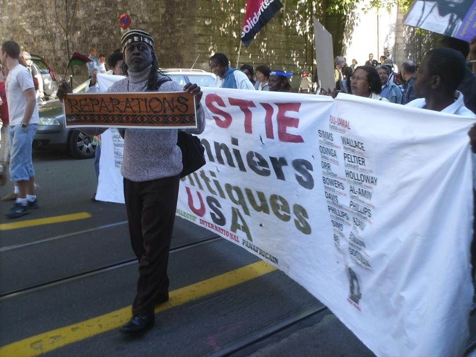 Jahahara-marches-for-reparations-implementation-Durban-Declaration-inc.-freedom-for-US-political-prisoners-at-UN-Geneva-2009-by-Kali-Akuno, Reparations now! Pass HR 40!, Culture Currents