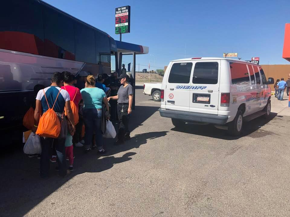 Sheriff-transfers-migrants-to-Greyhound-bus-in-Deming-N.M.-by-Tiny, Caging poor people: Occupied Land Truth Tour through Southwest Turtle Island, National News & Views