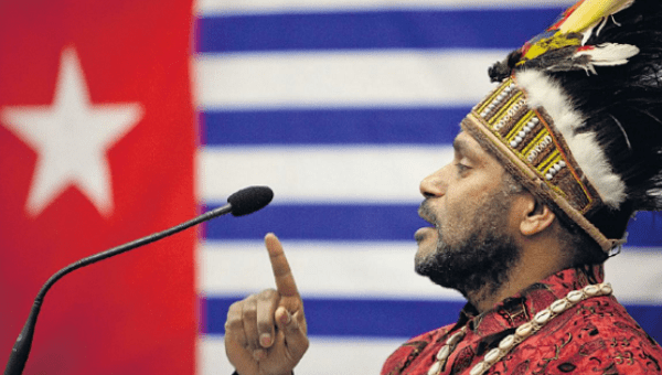 Benny-Wenda-speaks-before-West-Papuan-flag, United Nations intervention urgently needed to stop colonial carnage in West Papua, World News & Views