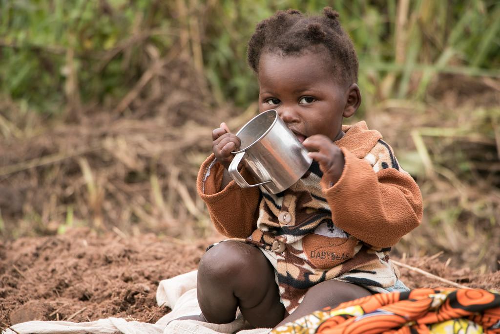 Kalonga-Kabila-Kabala-Congolese-internally-displaced-child-holds-empty-cup-2016-Kasai-region, Foreign aid for Rwanda, suffering for Rwandans and Congolese, World News & Views