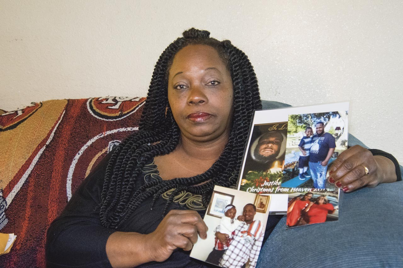 Barbara-Doss-holds-photos-of-son-Dujuan-Armstrong-who-died-in-Santa-Rita-Jail-by-Scott-Morris-East-Bay-Express, Santa Rita Jail prisoners stage hunger strike and work stoppage to protest filthy conditions, price gouging and abuse, Behind Enemy Lines