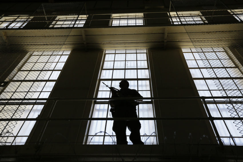 Guard-stands-watch-over-East-Block-on-San-Quentin's-Death-Row-by-Eric-Risberg-AP, A key reparation to descendants of slaves wouldn't cost a dime, Behind Enemy Lines
