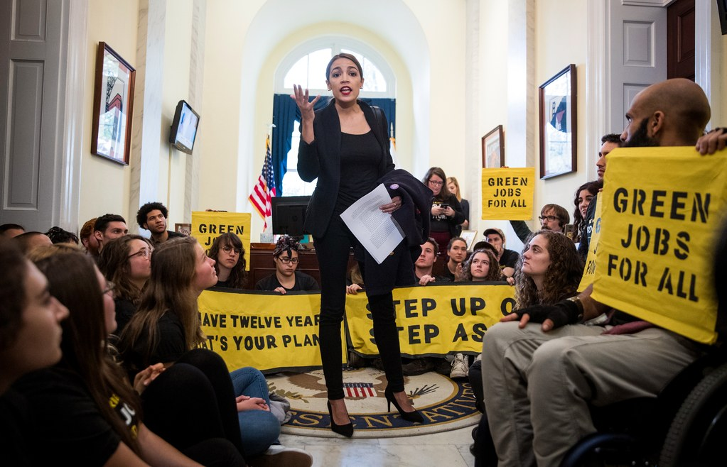 Congresswoman-Alexandria-Ocasio-Cortez-rallies-protesters-sitting-in-outside-Pelosis-office-to-push-Green-New-Deal-1118-by-Sarah-Silbiger-NYT, In Texas, environmental racism is in our FACE, Behind Enemy Lines