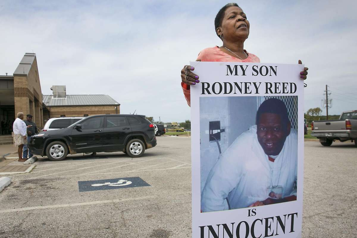 Death-row-prisoner-Rodney-Reed's-mother-Sandra-Reed-shows-placard-during-break-in-hearing-Bastrop-County-District-Court-101017-by-Ralph-Barrera-Austin-American-Statesman, New clemency system could turn Rodney Reed's 20 years of injustice into 20 days, Behind Enemy Lines Featured