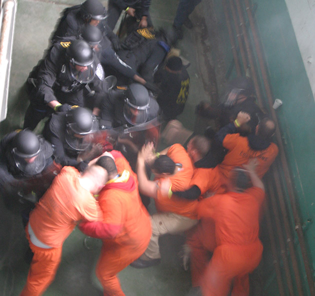 Prison-melee-prisoners-vs.-guards-by-Dave-Gilson, The reality of federal prison, Part 1, Behind Enemy Lines
