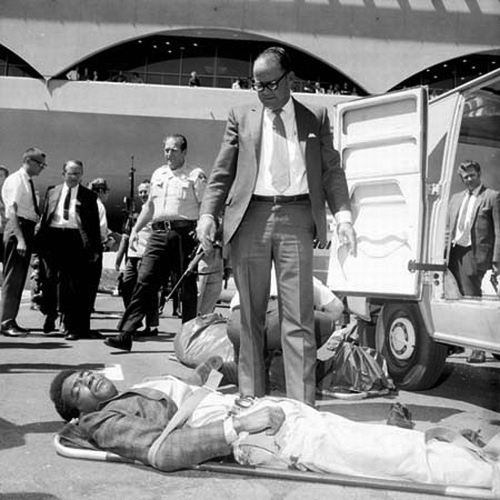 Ruchell-Magee-gravely-injured-on-stretcher-in-Marin-Courthouse-parking-lot-after-rebellion-080770, Restrictions on First Amendment speech rights warrant congressional investigation – later for impeachment, Behind Enemy Lines