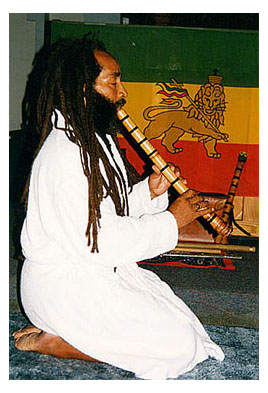 Veronza-Bowers-Jr.-playing-shakuhachi-flute-kneeling-1990, Veronza Bowers: In search of a sound – lessons from bamboo, Behind Enemy Lines Featured