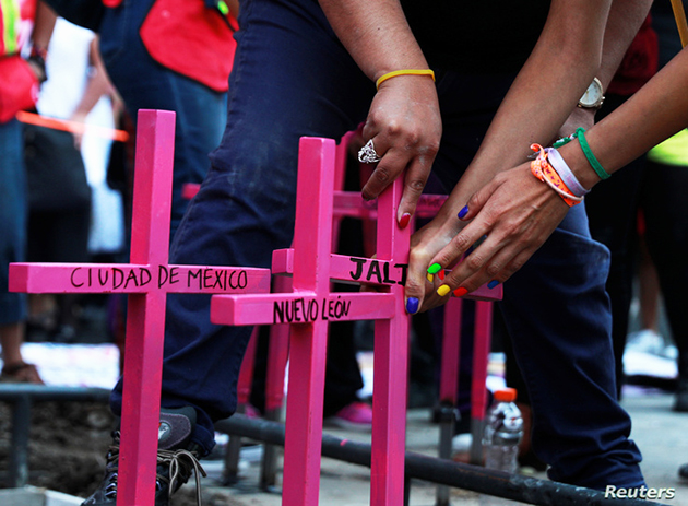 Women-place-pink-crosses-at-memorial-against-femicide-naming-states-of-Mexico-in-Mexico-City-032419-by-Reuters, California prisoners call for end to machismo and femicide in Mexico, World News & Views