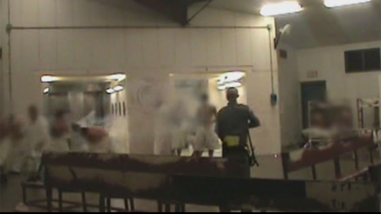 TDCJ-Lt.-Cody-Waller-shoots-tear-gas-directly-at-'motionless'-prisoners-051915-by-ABC13, Faces full of gas: Abuse of war crimes chemical weapons in Indiana prisons, Behind Enemy Lines