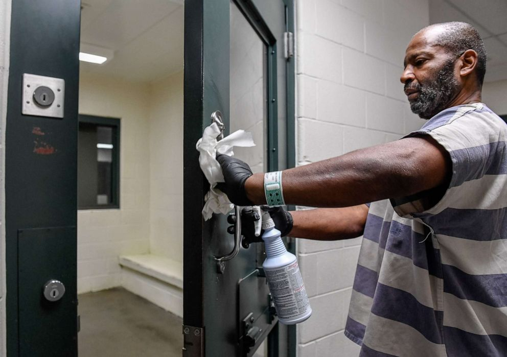 Prisoner-Mark-Garrett-cleans-holding-cell-of-coronavirus-at-Vanderburgh-County-Jail-Evansville-IN-by-Mike-Lawrence-Courier-Press, Outside organizers start a hotline to support incarcerated people through the COVID-19 outbreak, Behind Enemy Lines